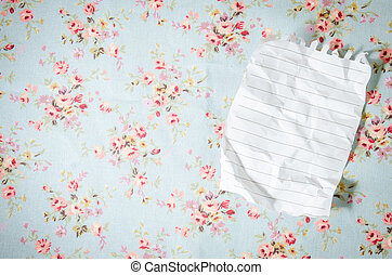 white empty sheet on tablecloth