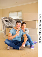 couple sitting on floor in new home