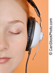 Woman in headphones - Redhead young woman in headphones....