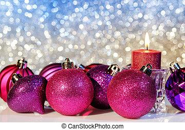 Christmas Balls - Purple Christmas balls and candle on a...