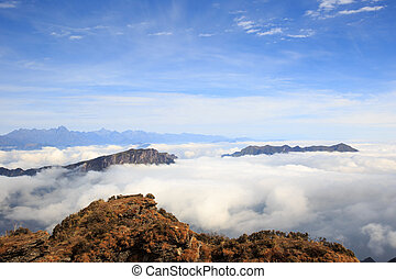 beautiful rolling clouds and mountain landscape