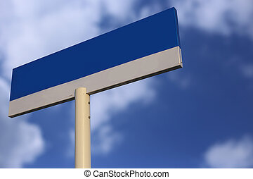 Blank Blue Road Sign with cloudy blue sky background