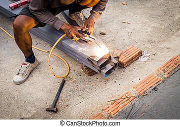 Close hand man arc welding or stick welding iron