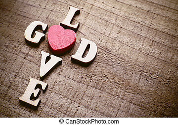 God is Love - God is love concept text lying on the rustic...