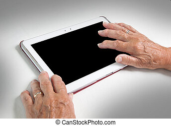 Hands of senior lady relaxing and reading the screen of her...