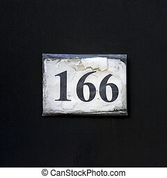 Number 166 - paper house number one hundred and sixty six,...