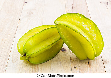 Star fruit or Carambola - Star fruit or Carambola on wood...