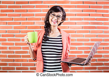 Asian college student with Laptop and coffee