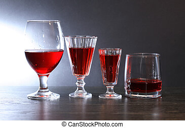 Cocktail Party - Evening drink. Few glasses with red liqueur...