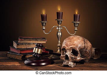 Still life art photography on human skull skeleton with...