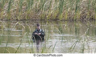 fisherman in the cane pond