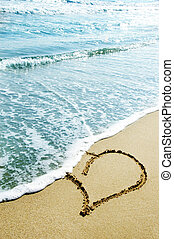 love - hearts drawn on the sand of the beach
