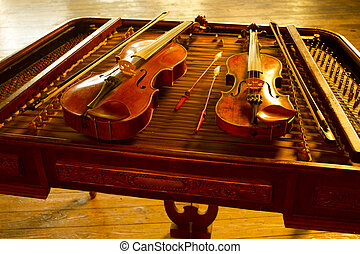 two music string instrument  in gold light on cimbalom