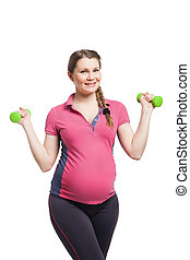 Young pregnant woman making exercise with dumb bells