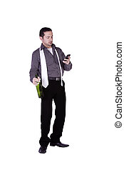 Businessman  with a bottle of drink texting