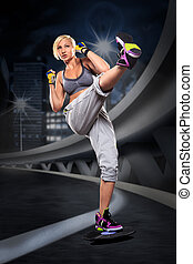 boxing  exercice - woman in sport dress at boxing exercise