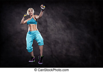 boxing exercice - woman in sport dress at boxing exercise on...