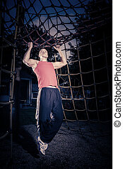 training - young man by training at outdoor fitness facility