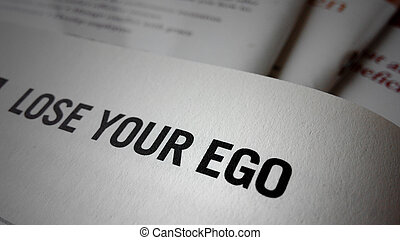 Lose your ego word on a book Business success concept
