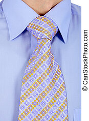 Properly tied business tie to a blue shirt