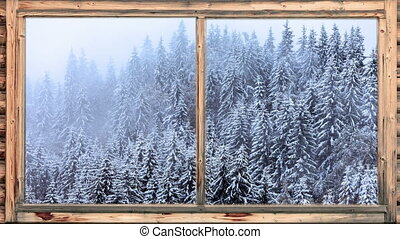 Heavy snow falling in wooded area seen through window
