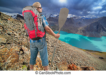 Tourist man on scenery mountain landscape background -...
