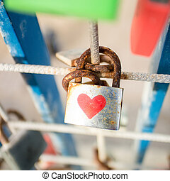 Padlock with heart - Rustic padlock with red heart on fence