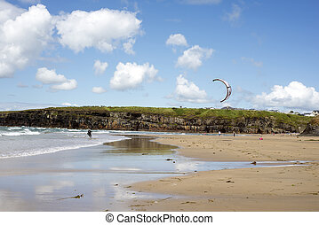 lone kite surfer getting ready at ballybunion beach on the...