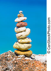 Work of art on the run - Stones in a pile put together with...