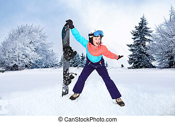 snowboarding - a teenage girl snowboarding in the Alps.