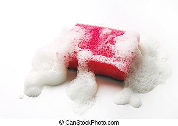 Sponge with foam on the table