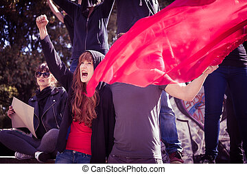 Demonstrators with red flag - Picture of young active...
