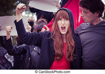 Female protester with raised fist - Image of chanted female...