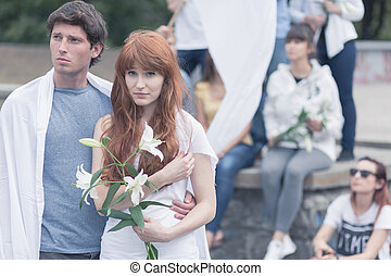 Protesting woman with white lilly - Image of protesting man...