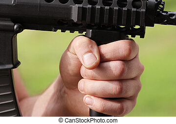 soldier hand with automatic weapon