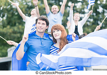 Protesters with flag of greece - Image of active protesters...