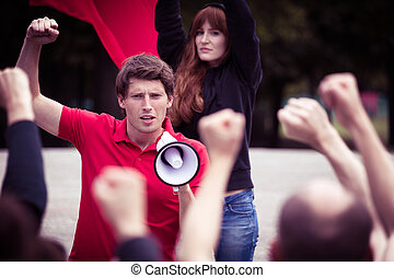 Young rebellious man with megaphone - Image of young...