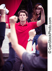 Protesting man with megaphone - Photo of protesting man with...