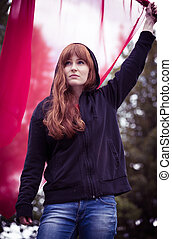 Rebellious woman with red flag - Photo of young rebellious...