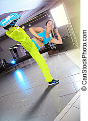 wushu - young woman in sport dress at wushu or tai chi...