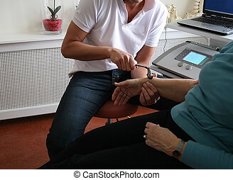 Physiotherapy - Physiotherapist uses hammer to test reflexes...