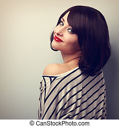 Beautiful makeup woman with short hair style posing in...