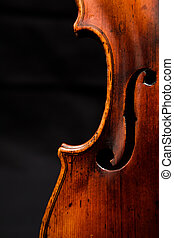 Violin detail - A detail from a beautifully tanned and worn...