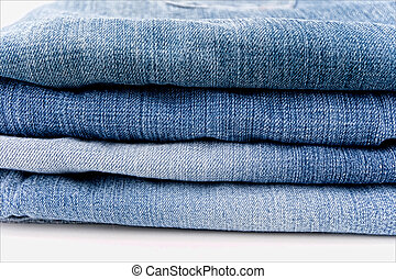 Blue jeans - A pile of jeans in shades of blue