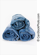 Rolled jeans on a white background