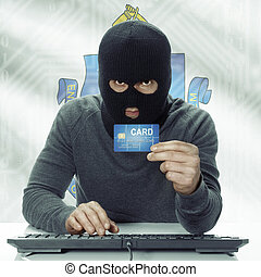 Dark-skinned hacker with USA states flag on background holding credit card - Massachusetts
