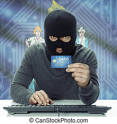 Dark-skinned hacker with USA states flag on background holding credit card - Maine