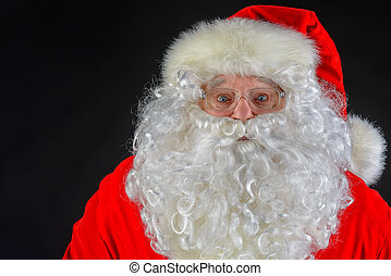 big eyes - Close-up portrait of Santa Claus over black...