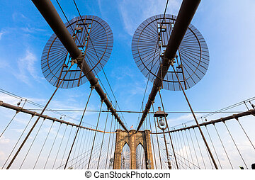 The Brooklyn Bridge is a hybrid cable-stayed/suspension...