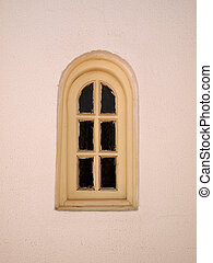 Old small window on textured wall of the house